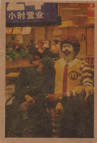 An old tired Chinese man leaning on a statue of Ronald McDonald.